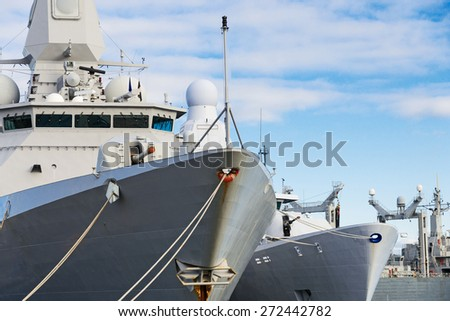 Close-up view of naval ships with guns. - stock photo