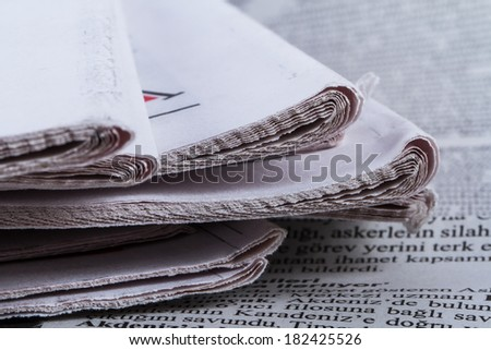 Close up view of newspapers.
