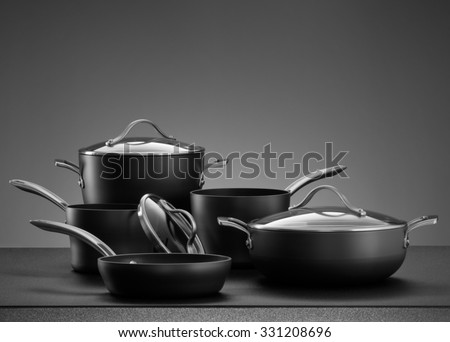 close up view of nice cookware set on grey color back - stock photo