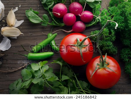 Close up view of nice fresh  vegetables on wooden back - stock photo