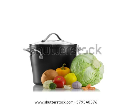 close up view of nice pot with some vegetables on white back - stock photo