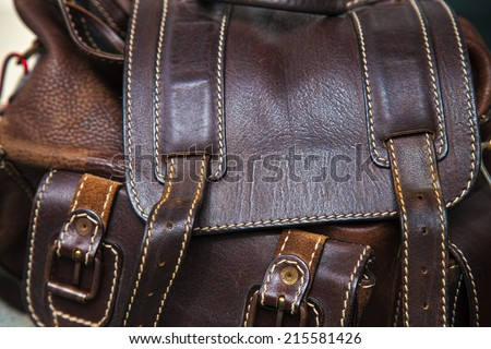 close up view of old rough brown leather bag - stock photo