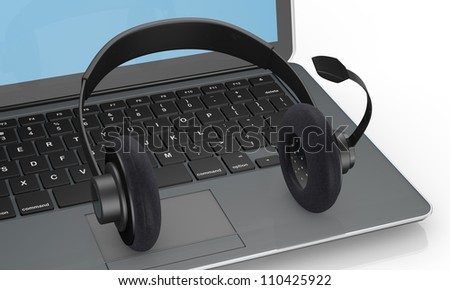 close up view of one computer notebook with headphones, concept of help desk or online communication (3d render)