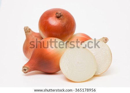 Close up view of onions isolated on a white background. - stock photo