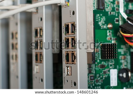 Close up view of opened router kits cluster that contain electronic board and electric ethernet connectors with blinking leds. Concept of recent technology design. - stock photo