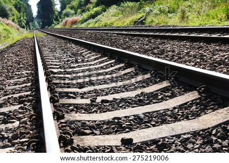 Close-up View of Railway Tracks through Countryside - stock photo