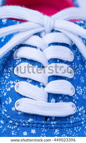 Close up view of shoe and laces - stock photo