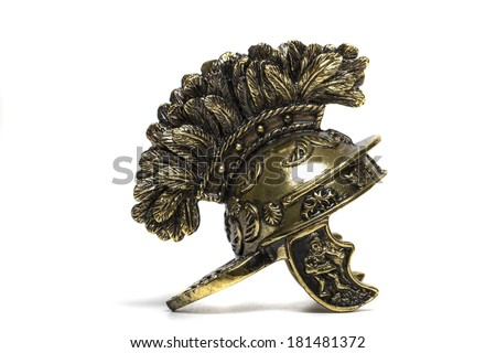 Close up view of small miniature roman helmet isolated on a white background. - stock photo