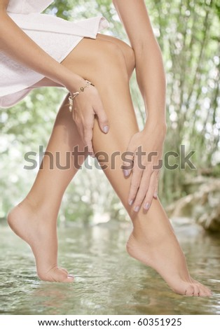 close up view of smooth woman�s legs in summer environment - stock photo