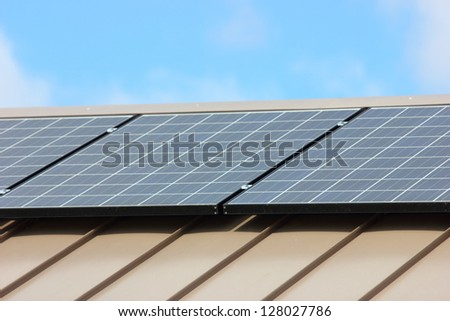 Close up view of solar panels laying on top of a building - stock photo