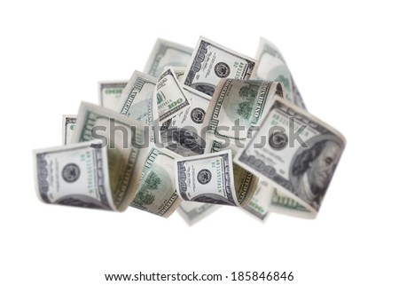 Close up view of stacked flying one hundred dollar banknotes with depth of field, isolated on white background.