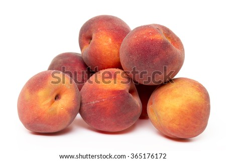 Close up view of sweet peaches isolated on a white background. - stock photo