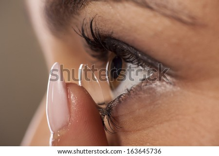 close-up view of the adjustment of contact lenses - stock photo