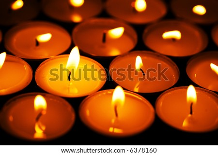 Close up view of the Candles on black - stock photo
