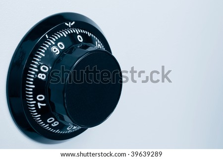 Close-up view of the combination safe lock. - stock photo