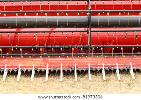 close-up view of the front of a combine harvester - stock photo