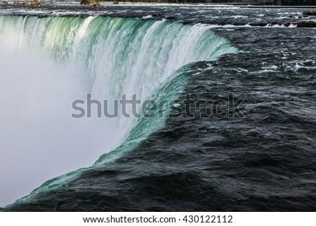 Close up view of the horse shoe falls at Niagara Falls in Ontario - stock photo