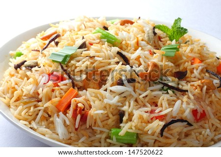 Close up view of The Indian Pulav- It is a medley of rice, vegetables and/or meat. The Basmati  rice is browned in oil and then mixed with vegetables, egg, chicken , nuts, fruits etc. - stock photo