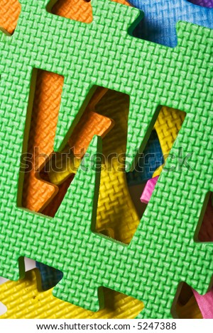 Close up view of the letter W on the color background - stock photo