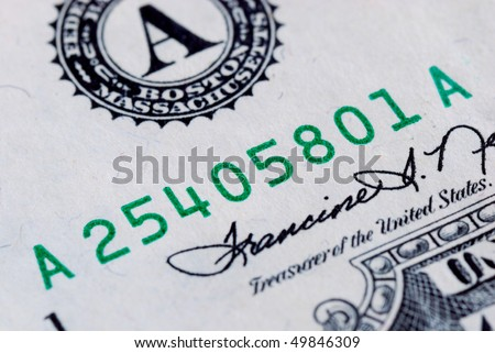 Close up view of the serial number of a dollar bill - stock photo