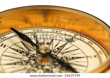 Close-up view of the vintage compass on a white background. - stock photo