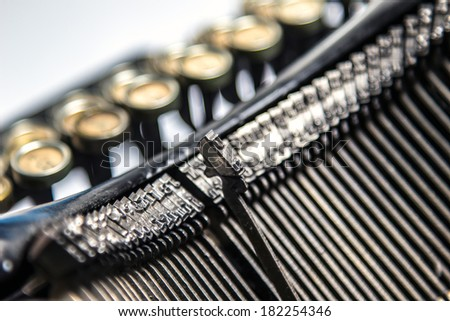 Close-up view of three letters on an old typewriter  - stock photo
