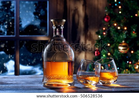 close up view  of two glasses with whiskey on color back