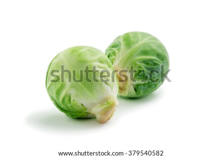 close up view of two heads of Brussels sprout on white back - stock photo