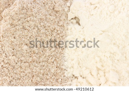 Close up view of two types of flour - whole grain / wholemeal and smooth - stock photo