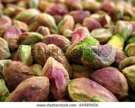 Close-up view of unsalted green pistachio nuts.