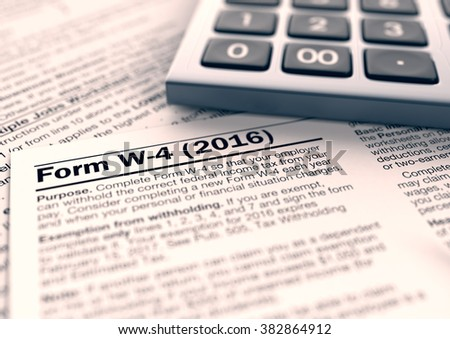 close up view of w-4 form for usa taxes with a pen (3d render)