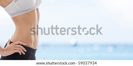 Close up view of well shaped womanâ??s body in summer environment - stock photo