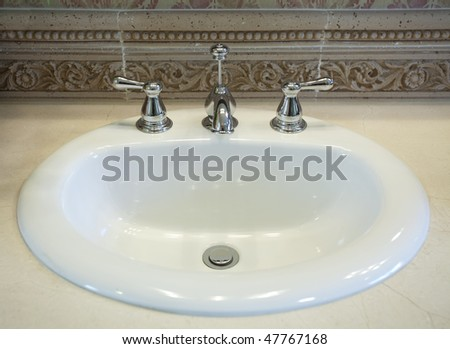 Close up view of white sink in the bathroom - stock photo