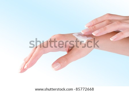Close up view of woman's hands on color back - stock photo