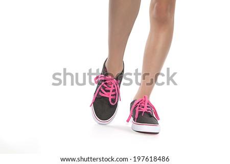close-up View of young women walking wearing shoes - stock photo