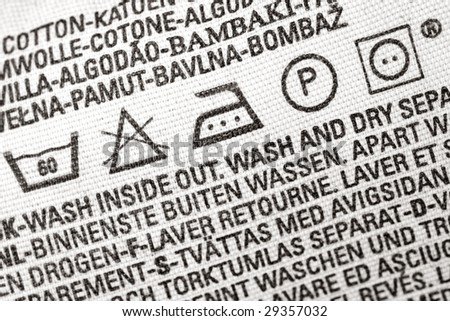 Close up view on an isolated washing label tag