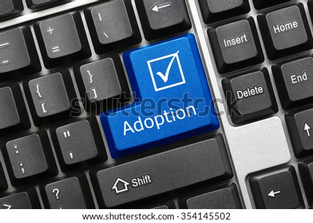 Close-up view on conceptual keyboard - Adoption (blue key) - stock photo