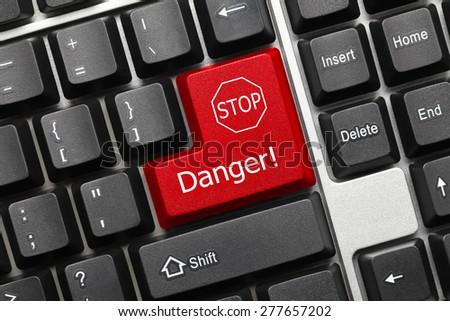 Close-up view on conceptual keyboard - Danger (red key with stop sign)