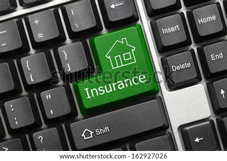 Close up view on conceptual keyboard - Insurance (green key with house icon)