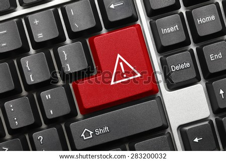 Close-up view on conceptual keyboard - Red key with attention sign - stock photo