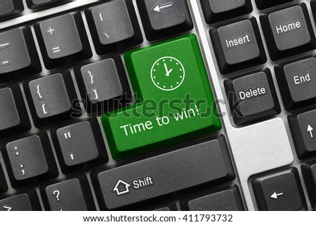 Close-up view on conceptual keyboard - Time to win (green key) - stock photo