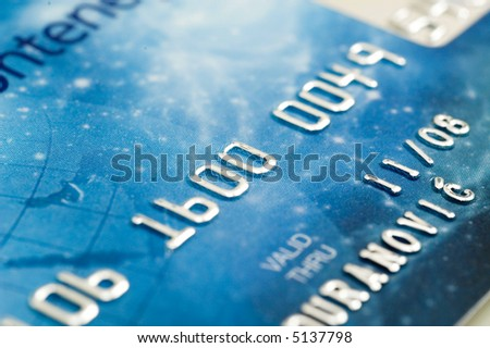 Close up view on credit cards numbers. - stock photo