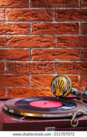 Close up view on gramophone on background of the brickwall - stock photo