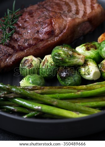 close up view on nice fresh steak on color background - stock photo
