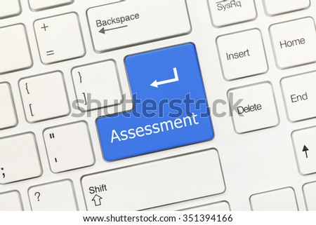Close-up view on white conceptual keyboard - Assessment (blue key) - stock photo