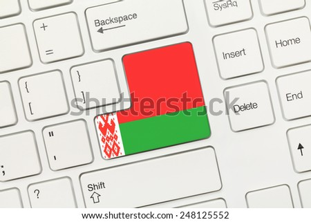 Close-up view on white conceptual keyboard - Belarus (key with flag)