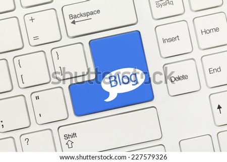Close-up view on white conceptual keyboard - Blog (blue key)