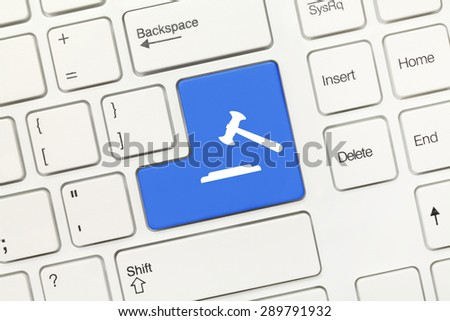 Close-up view on white conceptual keyboard - Blue key with gavel symbol - stock photo