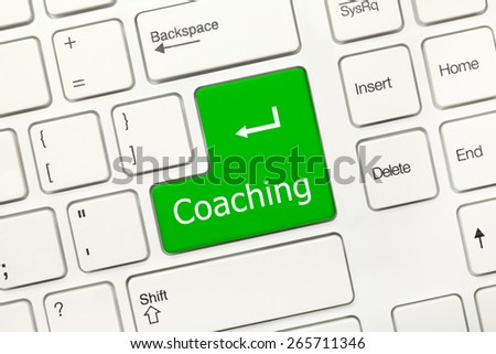 Close-up view on white conceptual keyboard - Coaching (green key) - stock photo