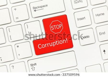 Close-up view on white conceptual keyboard - Corruption (red key) - stock photo